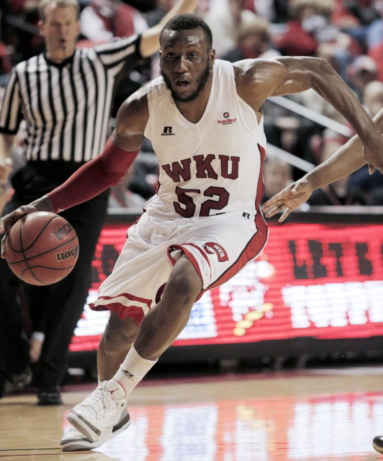 WKU junior guard T.J. Price drives the ball during the second half of WKU's game against Georgia State Thursday Jan. 9 in Diddle Arena. Price was the leading scorer for WKU with a total of 15 points. Georgia State defeated WKU 77-54 making WKU 2-1 in Sun Belt play this season.