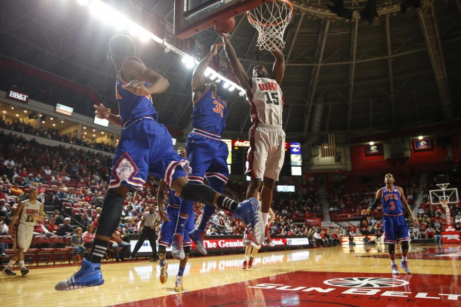WKU senior forward O'Karo Akamune (15) makes a layup during a basketball game between the Western Kentucky Hilltoppers and UT Arlington at E.A. Diddle Arena in Bowling Green, Ky. on Thursday, Jan. 30, 2014. (Jabin Botsford / College Heights Herald)