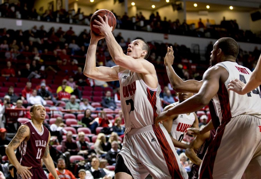 WKU sophomore center Aleksej Rostov shoots during the first half of WKU's game against the University of Arkansas Little Rock Thursday, Jan. 16, 2014 at Diddle Arena in Bowling Green, Ky.