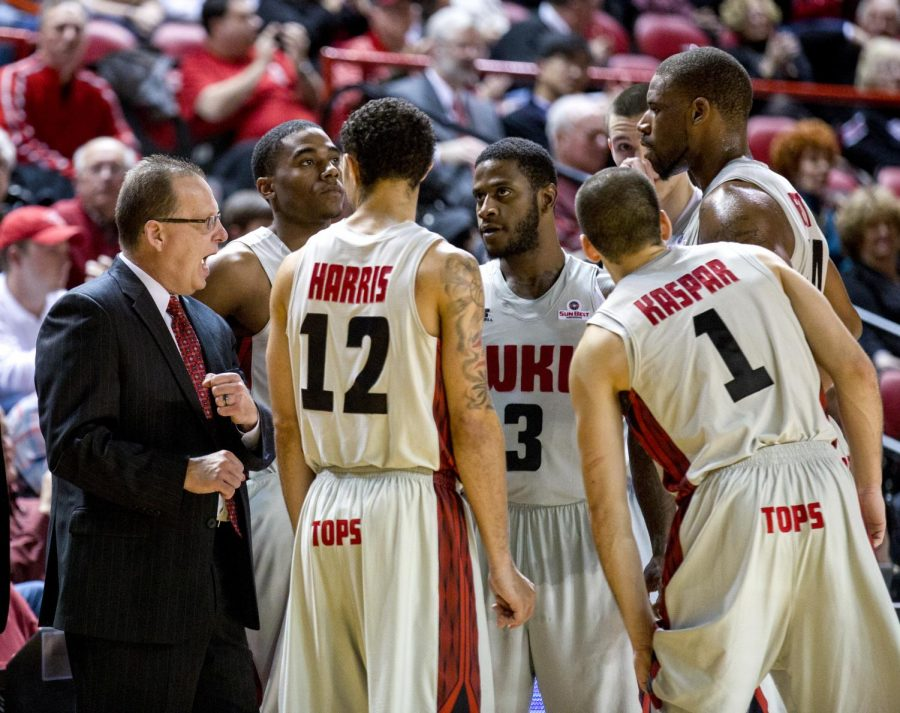 WKU head coach Ray Harper speaks to the Toppers during the second half of WKU's 83-87 overtime loss against the University of Arkansas Little Rock Thursday, Jan. 16, 2014 at Diddle Arena in Bowling Green, Ky.