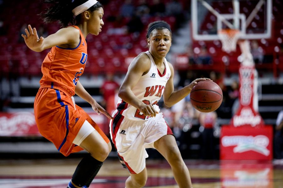 WKUs+senior+guard+Bianca+McGee+drives+past+guard+Tahlia+Pope+%2811%29+during+the+second+half+of+WKUs+match+against+the+University+of+Texas+at+Arlington+Wednesday%2C+Jan.+29+at+Diddle+Arena.+The+Lady+toppers+pulled+off+a+59-46+victory%2C+and+McGee+led+the+teams+score+total+with+17+points.+%28Mike+Clark%2FHERALD%29