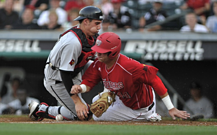 Junior infielder Ryan Huck slides into home plate in the bottom of the second inning to score a run Tuesday night at Bowling Green Ballpark. WKU beat the No. 18 ranked, in-state rival Louisville 8-1.