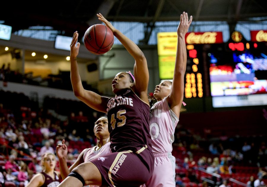 Texas+State%27s+center+Ashley+Ezeh+%2845%29+beats+junior+forward+Chastity+Gooch+%2830%29+for+a+rebound+during+the+first+half+of+WKU%E2%80%99s+game+against+Texas+State+on+Saturday%2C+Feb.+1%2C+2014+at+Diddle+Arena+in+Bowling+Green%2C+Ky.+The+Toppers+struggled+early+but+lead+31-26+at+the+half.