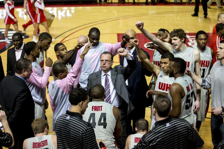 WKU's head coach Ray Harper (center) leads the Toppers in a cheer during a timeout in the second half of WKU's 68-64 victory over Texas State on Saturday, Feb. 1, 2014 at Diddle Arena in Bowling Green, Ky.