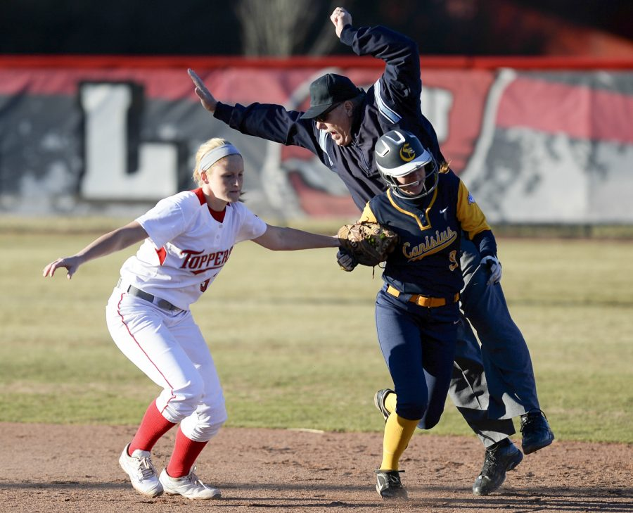 WKU senior infielder Amanda Thomas tags Canisius senior infielder Valorie Nappo as she attempted to steal the base in WKU's win of 8-1 against Canisius on Friday Feb. 21, 2014 at the WKU softball complex in Bowling Green, Ky. (Jeff Brown/HERALD)