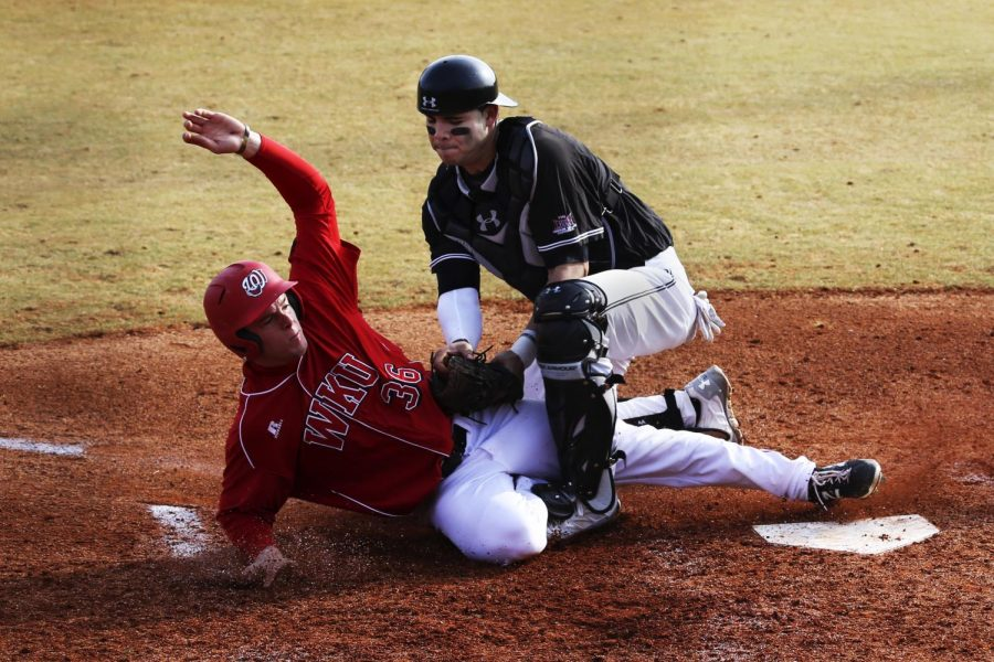 WKU+sophomore+outfielder+Trevor+Lowe+safely+slides+into+home+plate+as+Southern+Illinois+freshman+catcher+Nick+Rybarczyk+fails+to+tag+him+out+during+the+second+inning+of+the+second+game+at+Nick+Denes+field+on+Sunday%2C+Feb.+16.+%28Tyler+Essary%2FHERALD%29