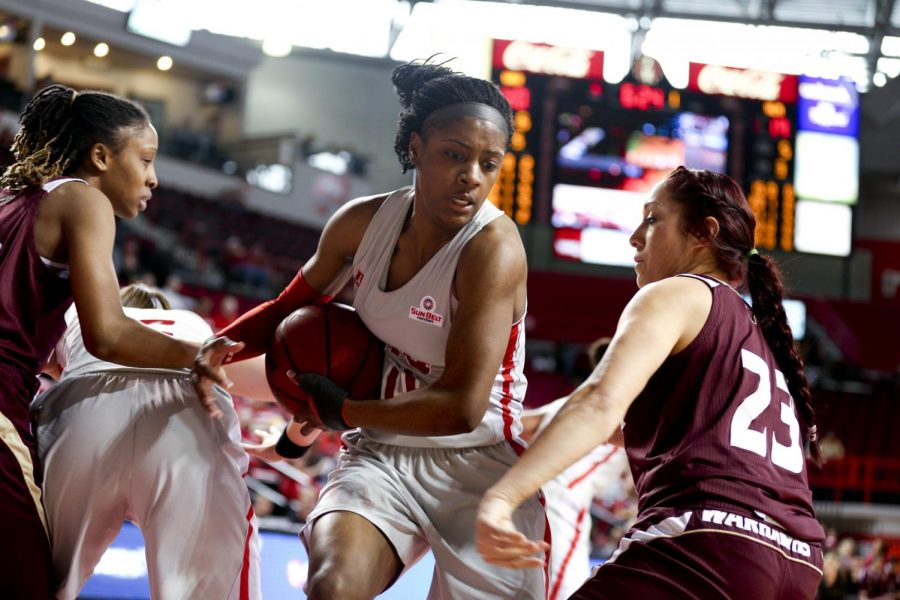 WKU+junior+guard+Chanell+Lockhart+%284%29+rebounds+the+ball+on+the+defensive+side+during+the+first+half+of+the+women%27s+basketball+game+against+Louisiana-Monroe+on+Saturday+in+Diddle+Arena.+%28Kreable+Young%2FHERALD%29