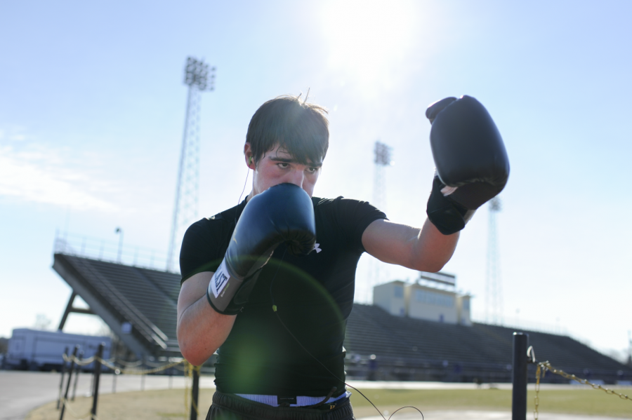 Bowling Green sophomore Chase Proctor shadow boxes around the track at Bowling Green High School in preparation for Sigma Chi Fight Night. Proctor is one of several WKU students who will be fighting tonight at the Blue Dome in Lampkin Park. (Ian Maule/HERALD)