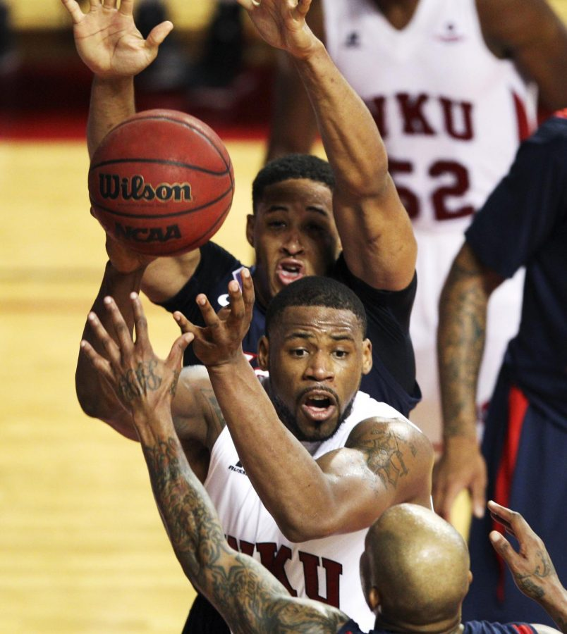 WKU forward George Fant (44) looks for a player to pass to during the second half of Saturday's game against South Alabama at Diddle Arena. South Alabama won 69-62. (Austin Anthony/HERALD)