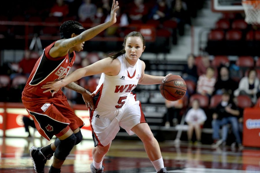 Sophmore+guard+Micah+Jones+drives+past+Arkansas+State+sophomore+guard+Britteny+Gill+during+the+first+half+of+their+game+Saturday+at+Diddle+Arena.