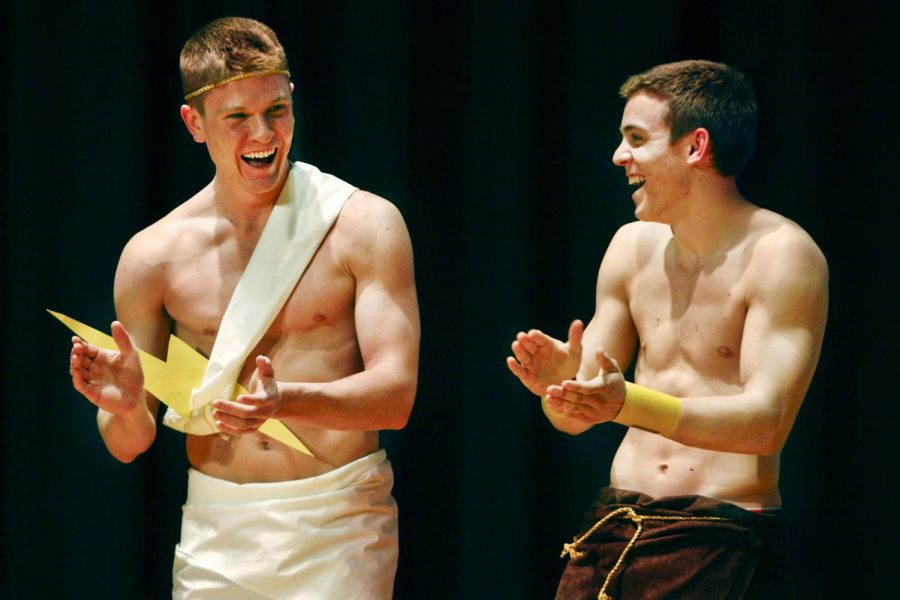 Bonnieville junior Kyle Mekilney and Louisville freshman Michael Bryar, both of Alpha Tau Omega, react as they are announced the winning couple of Omega Phi Alphas Beauty and the Greek pageant on Wednesday night in the Downing Student Union auditorium. (Kreable Young/HERALD)