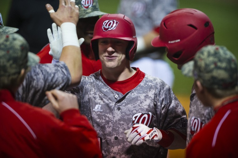 WKU+sophomore+infielder+Scott+Wilcox+celebrates+with+teammates+after+scoring+a+home+run+during+game+two+of+Saturday%27s+doubleheader+at+Nick+Denes+Field.+WKU+beat+Toledo+9-3+in+February+2012.%C2%A0