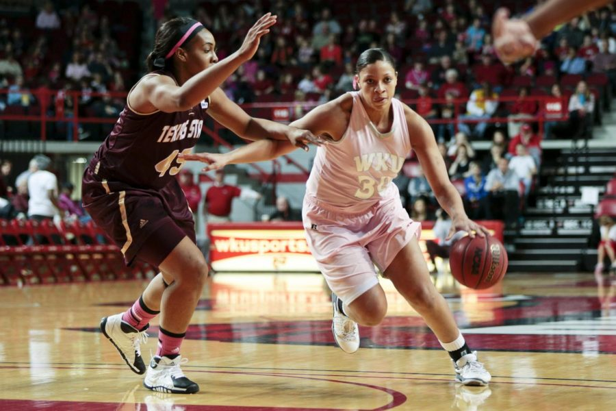 WKU junior forward Chastity Gooch (30) attempts to get the ball past Texas State center Ashley Ezeh (45) during the game at Diddle Arena on Saturday. WKU lost 63-72.