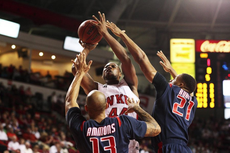 WKU forward George Fant (44) shoots over South Alabama Jaguars forwards Mychal Ammons (13) and Augustine Rubit (21) during the first half of Saturday's game against South Alabama at Diddle Arena. South Alabama lead 26-14. (Austin Anthony/HERALD)