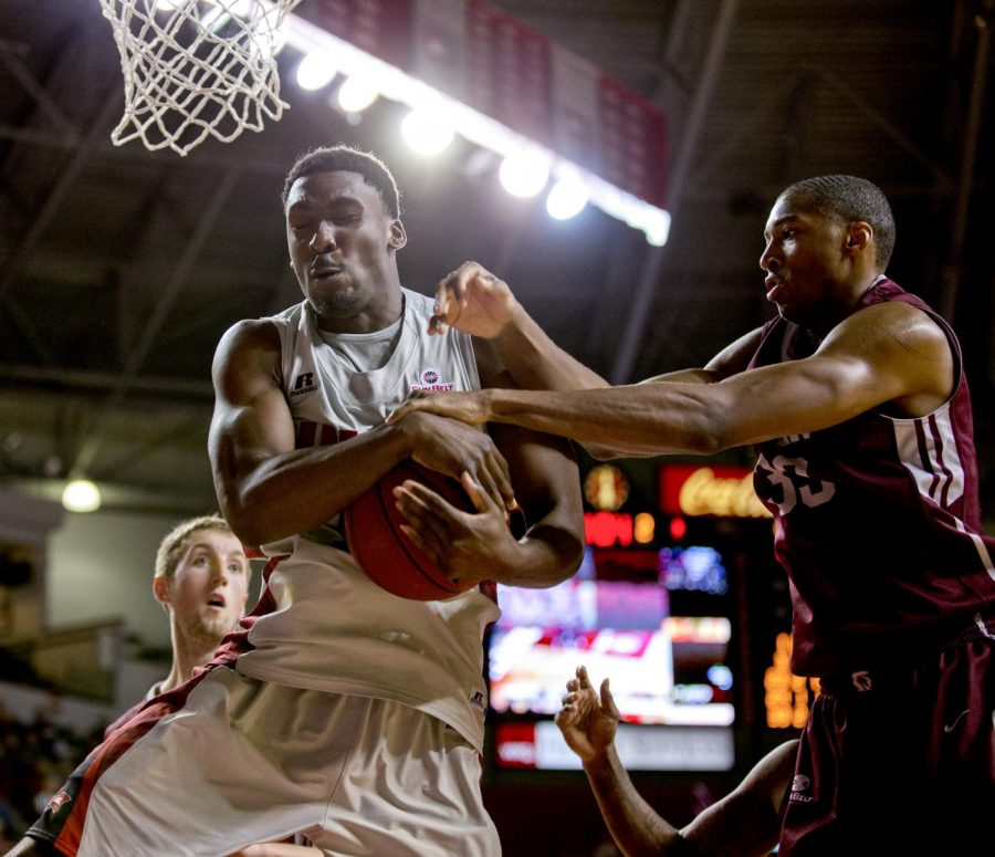 WKU senior forward Akamune O'Karo protects a rebound from UALR forward James White during the second half of WKU's 83-87 overtime loss against the University of Arkansas Little Rock Thursday, Jan. 16, 2014 at Diddle Arena in Bowling Green, Ky.
