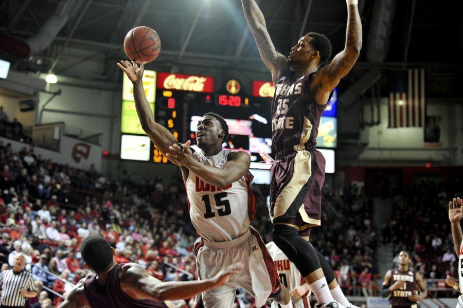 WKU senior forward O'Karo Akamune shoots the ball during the game against Texas State in Diddle Arena on Saturday, Feb. 1.