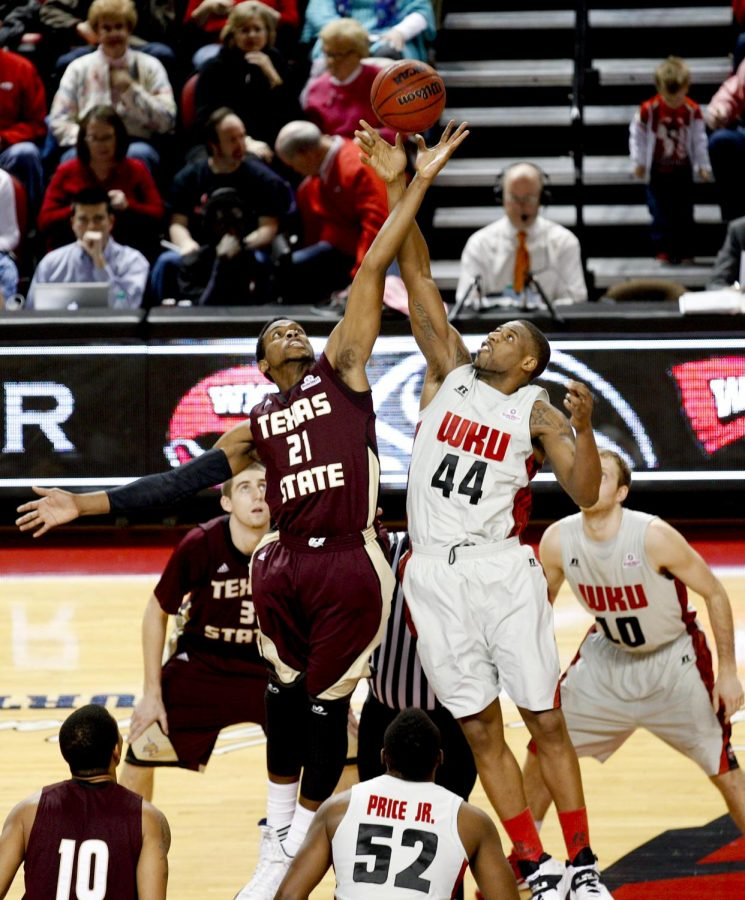 WKU's junior forward George Fant (44) faces Texas State forward Emani Gant (21) during the tipoff of WKU's game against Texas State on Saturday, Feb. 1, 2014 at Diddle Arena in Bowling Green, Ky.