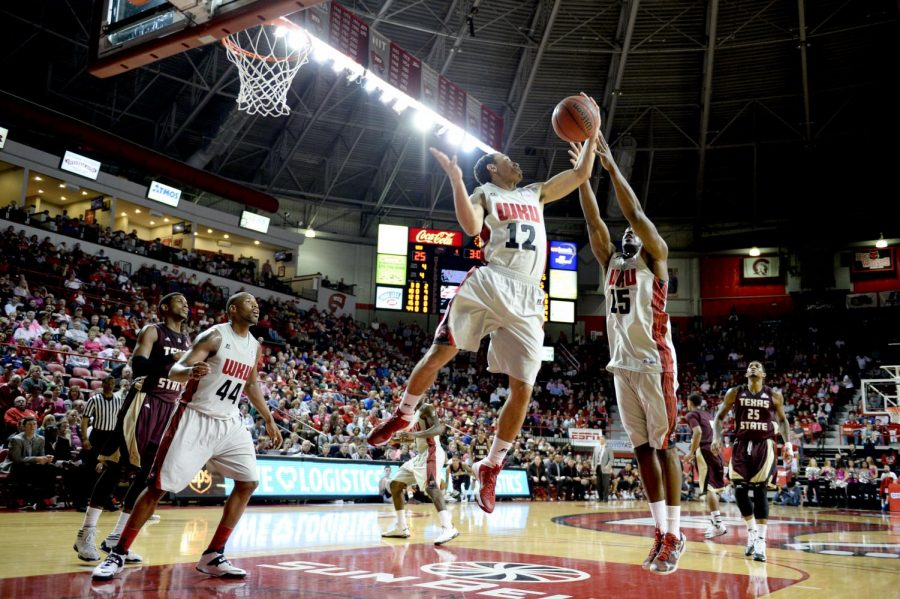 WKU senior guard Brandon Harris (12) rebounds the ball during the game against Texas State in Diddle Arena on Saturday, Feb. 1.