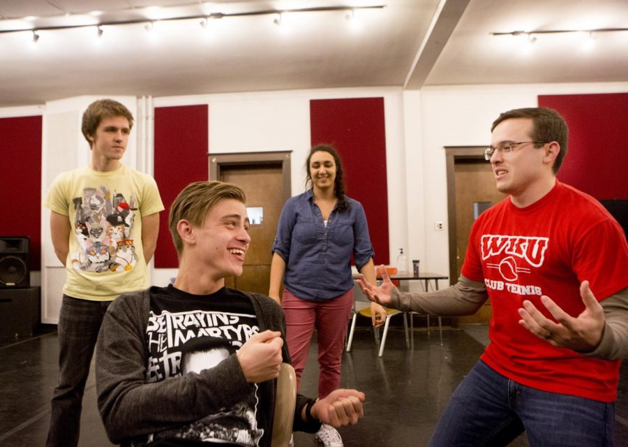 Frankfort freshman Isaac Barnes, Glasgow junior Matthew Zuccari, Louisville junior Sanya Monem, and Bowling Green senior Jacob Soler (left to right) perform a skit during Happy Gas rehearsal Tuesday night in preparation for their upcoming show, Its This or Dining Alone, in Pearce-Ford Tower on Thursday, Feb. 13. (Luke Franke/HERALD)