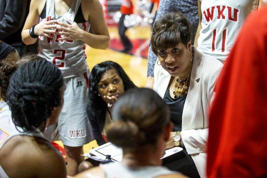 WKU head coach Michelle Clark-Heard speaks to the Lady Toppers during the second half of the Lady Topper's 80-71 victory over the University of Louisiana Lafayette Wednesday, March 5, 2014 at Diddle Arena in Bowling Green, Ky. (Mike Clark/HERALD)