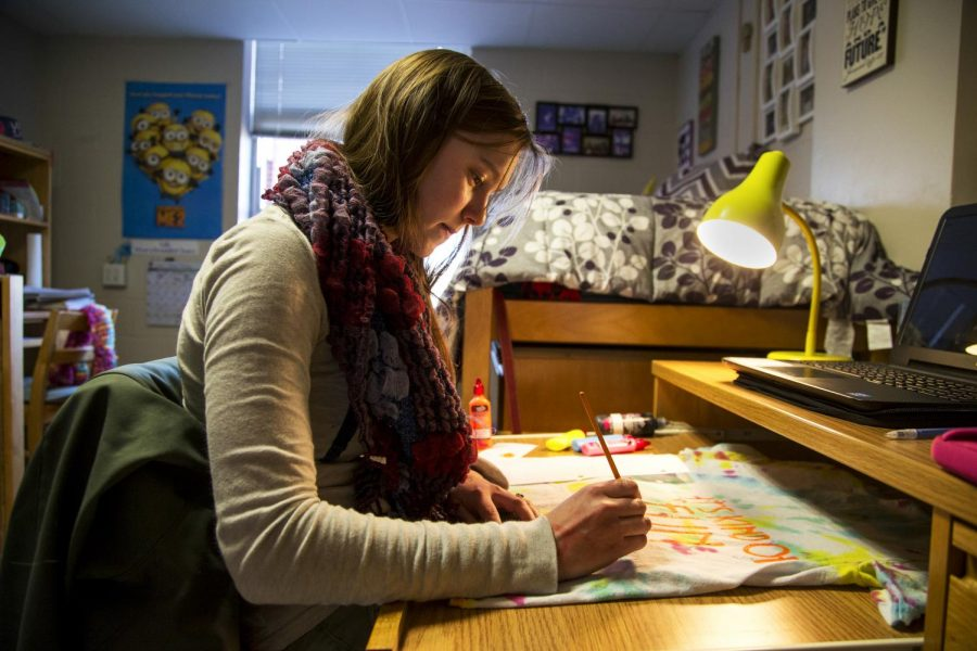 Russell Springs freshman Chloe Lawson works on a T-shirt design in her dorm room in Minton Hall on Feb. 28. Lawson said she has had a good experience living in the dorms and has become friends with her roommate. (Mike Clark/HERALD)