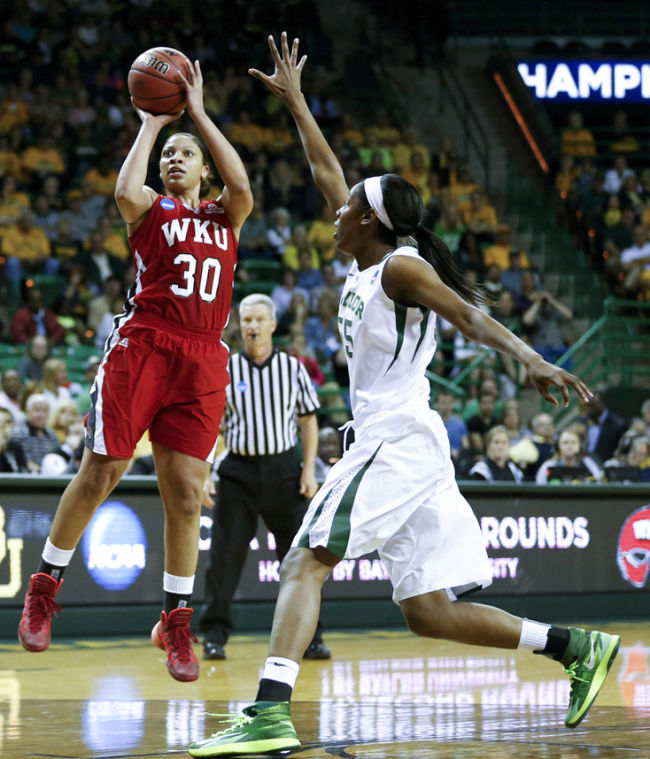 WKU junior forward Chastity Gooch shoots past Baylor freshman point guard Khadijiah Cave during the first round of the 2014 NCAA Divison I Women's Basketball Championship at the Ferrell Center in Waco, Texas on Saturday March 22, 2014. (Jeff Brown/HERALD)