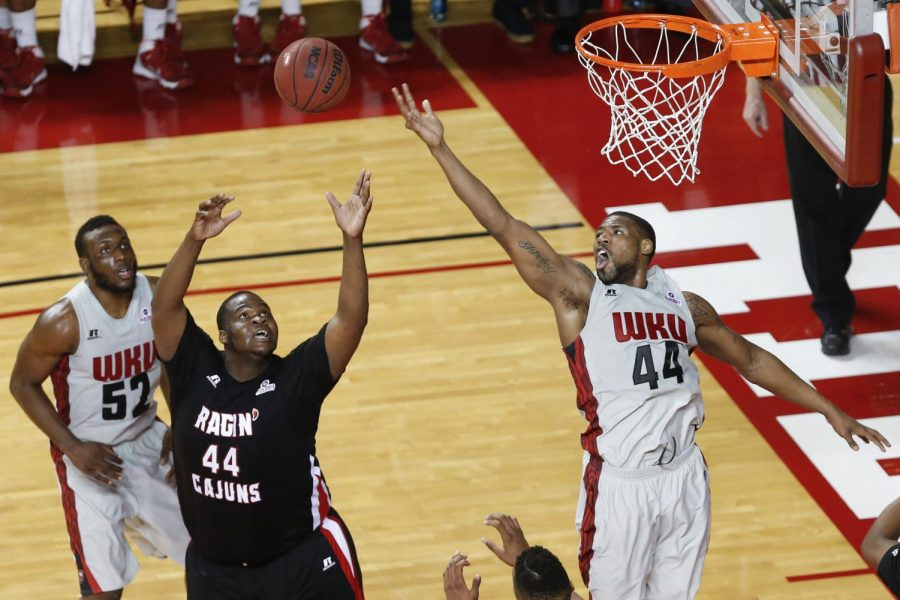 Western Kentucky Hilltoppers forward George Fant (44) and Louisiana-Lafayette center J.J. Davenport (44) jump for a rebound during the last home game of the regular season against Louisiana-Lafayette in Bowling Green, Ky. on Thursday, March 06, 2014. (Jabin Botsford/HERALD)