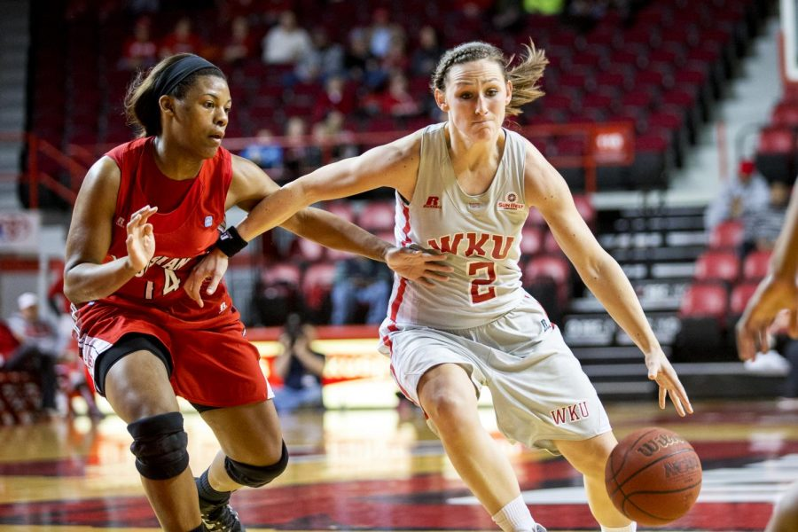 WKU+senior+guard+Chaney+Means+%282%29+drives+around+ULL%27s+guard+Adrienne+Prejean+%2814%29+during+the+first+half+of+the+Lady+Topper%27s+80-71+victory+over+the+University+of+Louisiana+Lafayette+Wednesday%2C+March+5%2C+2014+at+Diddle+Arena+in+Bowling+Green%2C+Ky.+%28Mike+Clark%2FHERALD%29
