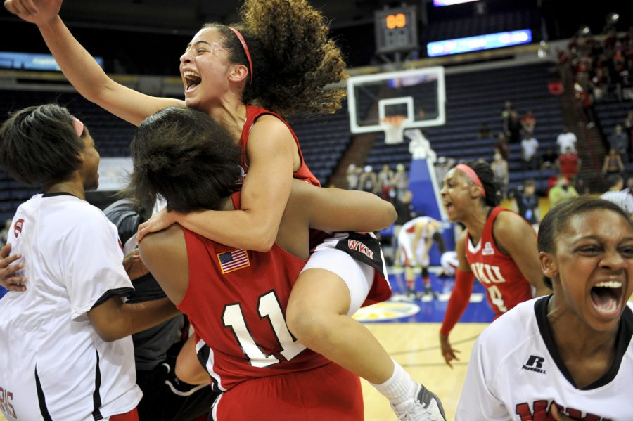 WKU freshman forward Bria Gaines (11) celebrates with WKU junior guard Ileana Johnson after their 61-60 victory over Arkansas State in the 2014 Women's Sun Belt Tournament Championship at Lakefront Arena in New Orleans, La. on Saturday Mar. 15, 2014. (Jeff Brown/HERALD)