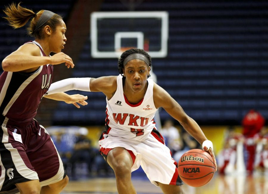 WKU+junior+guard+Chanell+Lockhart+%284%29+tries+to+get+around+UALR+Taylor+Ford+%282%29+during+the+first+half+of+WKUs+game+against+the+University+of+Arkansas+Little+Rock+in+the+semifinal+round+of+the+Sun+Belt+Tournament+Friday%2C+March+14%2C+2014%2C+at+Lakefront+Arena+in+New+Orleans%2C+La.+The+Lady+Toppers+won+66-62.+%28Mike+Clark%2FHERALD%29