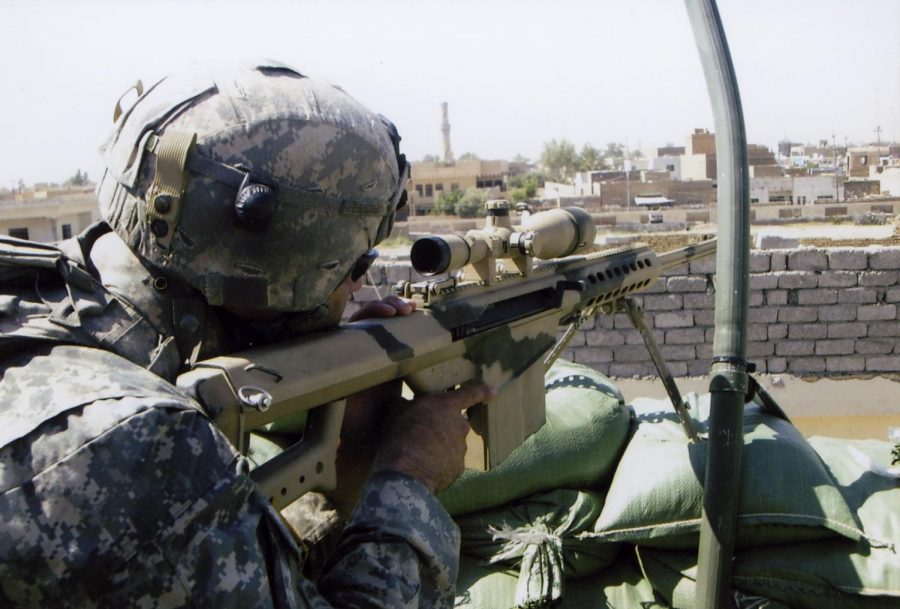 Fred Rowe provides sniper fire during an insurgent complex attack in Baiji, Iraq in 2007. Rowe was wounded twice that day. Photo provided by Fred Rowe.