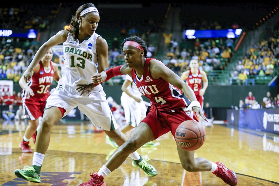 WKU junior guard Chanell Lockhart tries to drive the ball past Baylor freshman forward Nina Davis during the first round of the 2014 NCAA Divison I Women's Basketball Championship at the Ferrell Center in Waco, Texas on Saturday March 22, 2014. (Jeff Brown/HERALD)