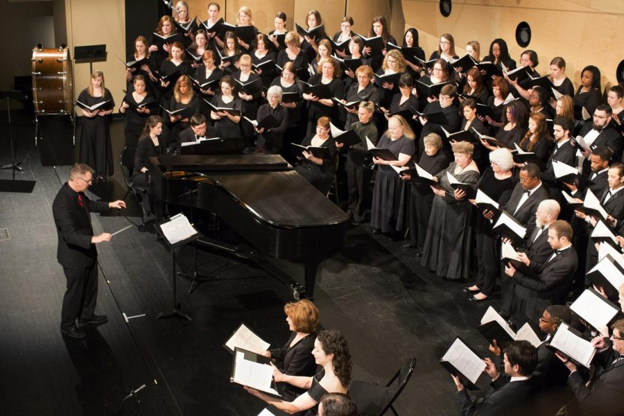 The Southern Kentucky Choral Society, directed by WKU professor Dr. Paul Hondorp, performs during a concert at Van Meter Hall on Sunday March 23, 2014. The choral group was also accompanied by the WKU mens and womens chorus, the Redshirts, and the WKU Chorale. (Luke Franke/HERALD)