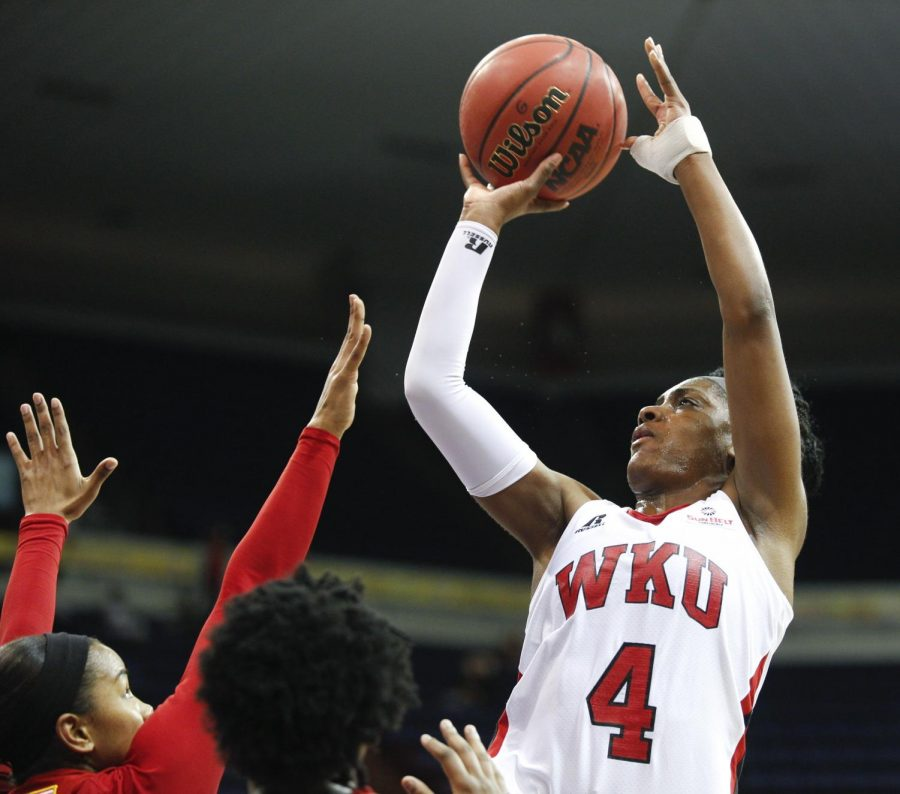 WKU%27s+junior+guard+Chanell+Lockhart+%284%29+shoots+a+three-pointer+during+the+first+half+of+WKU%27s+game+against+the+University+of+Louisiana+Lafayette+in+the+first+round+of+the+Sun+Belt+Tournament+Wednesday%2C+March+12%2C+2014%2C+at+Lakefront+Arena+in+New+Orleans%2C+La.+%28Mike+Clark%2FHERALD%29