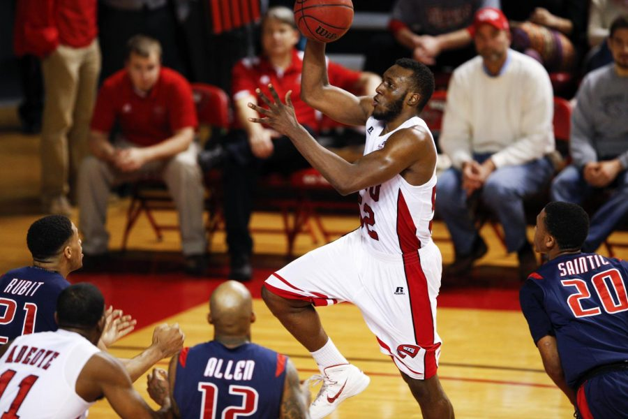 WKU's junior guard T.J. Price (52) goes up for a layup during the first half of WKU's game against South Alabama on Saturday, Feb. 15, 2014 at Diddle Arena in Bowling Green, Ky. (Mike Clark/HERALD)