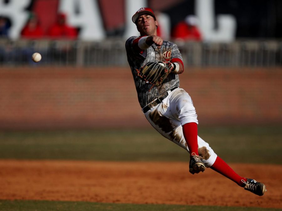 Shortstop+Cody+Wofford+makes+a+throw+on+the+run+during+the+team%27s+4-3+victory+over+Illinois+in+the+first+game+Saturday.+The+Hilltoppers+won+both+games+of+the+double+header.+%28Austin+Anthony%2FHERALD%29