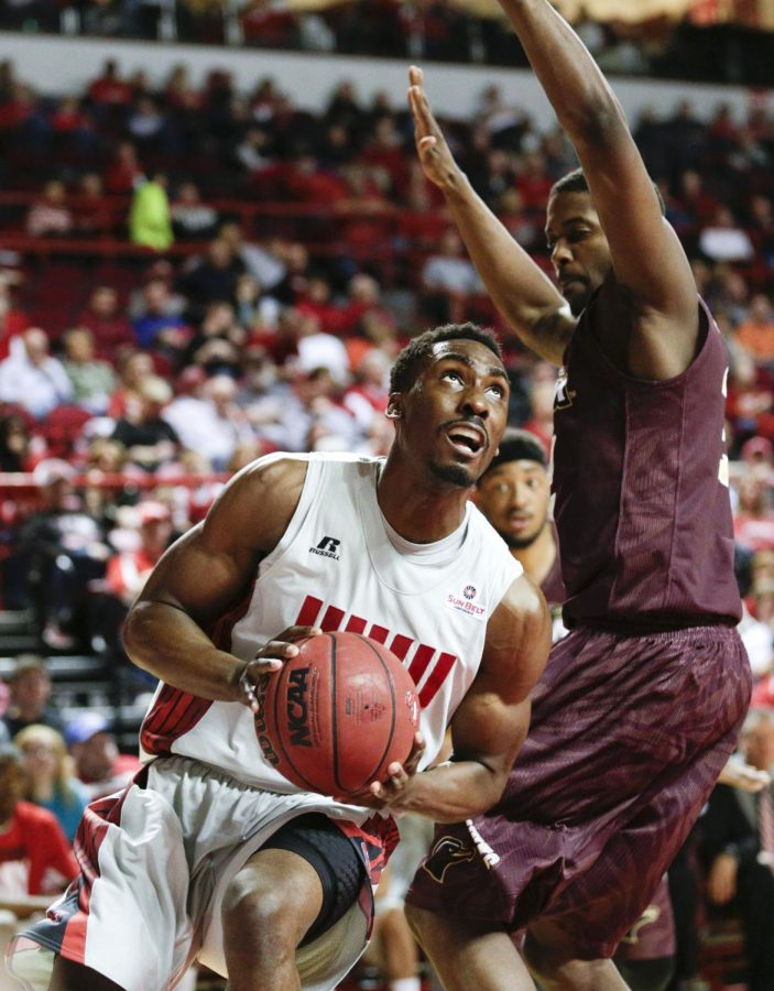 WKU's senior forward O'Karo Akamune (15) drives around ULM's forward DeMondre Harvey (2) during the second half of WKU's 72-63 victory over the University of Louisiana-Monroe Saturday, Feb. 22, 2014 at Diddle Arena in Bowling Green, Ky. (Mike Clark/HERALD)