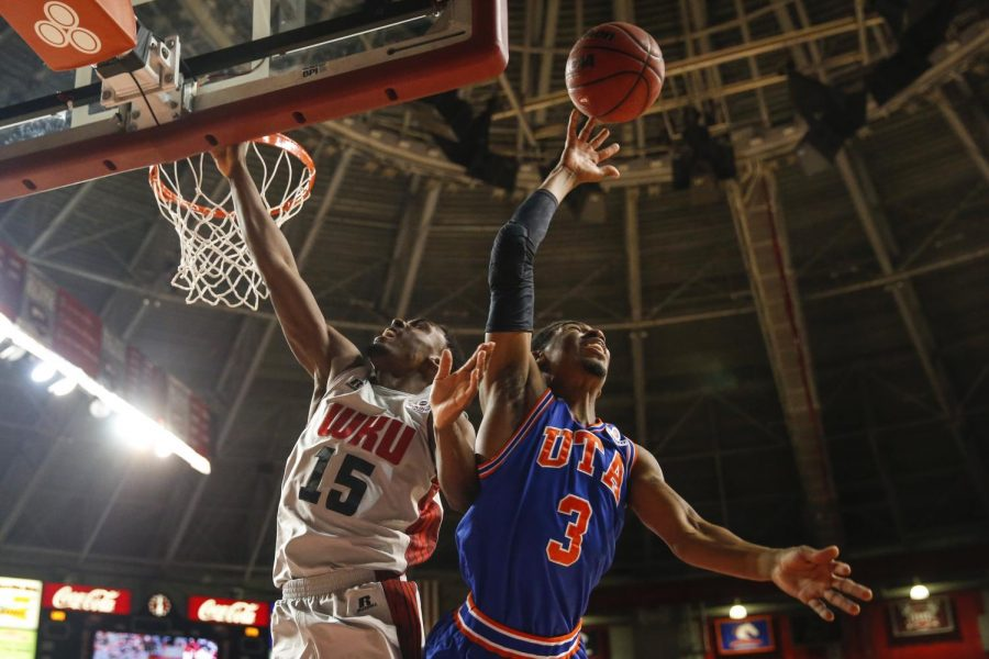 WKU senior forward O'Karo Akamune (15) and UT Arlington guard Jamel Outler (3) fight for a rebound during a basketball game between the Western Kentucky Hilltoppers and UT Arlington at E.A. Diddle Arena in Bowling Green, Ky. on Thursday, Jan. 30, 2014. (Jabin Botsford / College Heights Herald)