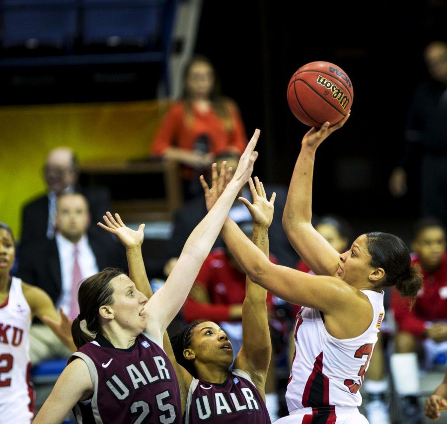 WKU junior forward Chastity Gooch (30) shoots over UALR forward Hannah Fohne (25) and guard Di'Mond Jackson (3) during the second half of WKU's 66-62 win over the University of Arkansas Little Rock in the semifinal round of the Sun Belt Tournament Friday, March 14, 2014, at Lakefront Arena in New Orleans, La. (Mike Clark/HERALD)