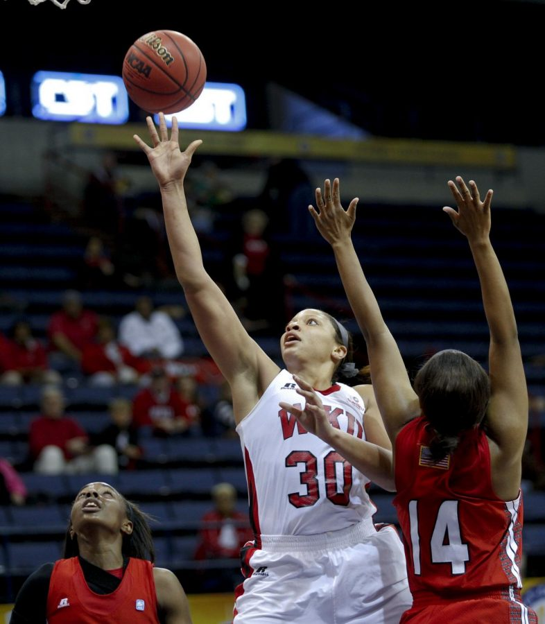 WKU's junior forward Chastity Gooch (30) shoots over ULL's forward Adrienne Prejean (14) during the first half of WKU's game against the University of Louisiana Lafayette in the first round of the Sun Belt Tournament Wednesday, March 12, 2014, at Lakefront Arena in New Orleans, La. (Mike Clark/HERALD)
