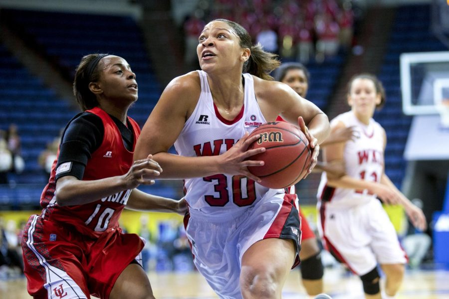 WKU%27s+junior+forward+Chastity+Gooch+%2830%29+drives+around+ULL%27s+guard+Kia+Wilridge+%2810%29+making+a+basket+and+drawing+a+foul+giving+the+Lady+Toppers+a+3-point+lead+with+less+than+two+minutes+to+play+during+WKU%27s+67-61+victory+over+the+University+of+Louisiana+Lafayette+in+the+first+round+of+the+Sun+Belt+Tournament+Wednesday%2C+March+12%2C+2014%2C+at+Lakefront+Arena+in+New+Orleans%2C+La.+Gooch+would+lead+the+Lady+Toppers+with+21+points+for+the+night.+%28Mike+Clark%2FHERALD%29