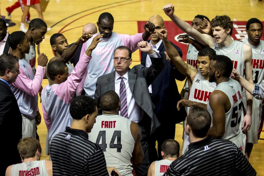 WKU's Head Coach Ray Harper (center) leads the Toppers in a cheer during a timeout in the second half of WKUÕs 68-64 victory over Texas State on Saturday, Feb. 1, at Diddle Arena. (Mike Clark/HERALD)