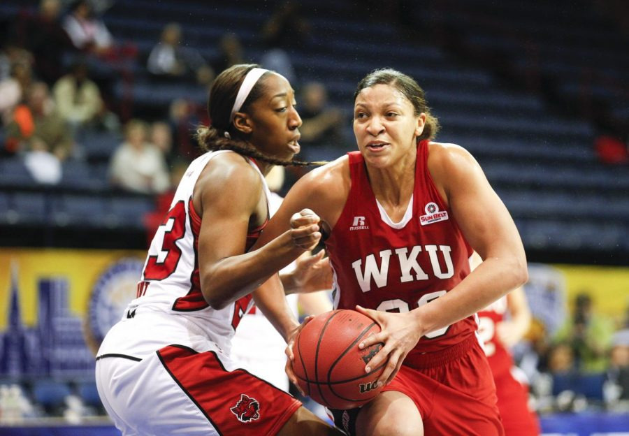 WKU's junior forward Chastity Gooch (30) drives around ASU's forward Jasmine Hunt (23) during the second half of WKU's 61-60 victory Arkansas State in the championship game of the Sun Belt Tournament Saturday, March 15, 2014, at Lakefront Arena in New Orleans, La. Gooch led the Lady Toppers playing all 40 minutes and notching 26 points. The Lady Toppers secured a place in the NCAA tournament with their win. (Mike Clark/HERALD)