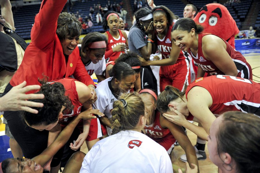 WKU+celebrates+their+61-60+victory+over+Arkansas+State+in+the+2014+Womens+Sun+Belt+Tournament+Championship+at+Lakefront+Arena+in+New+Orleans%2C+La.+on+Saturday+Mar.+15%2C+2014.+%28Jeff+Brown%2FHERALD%29