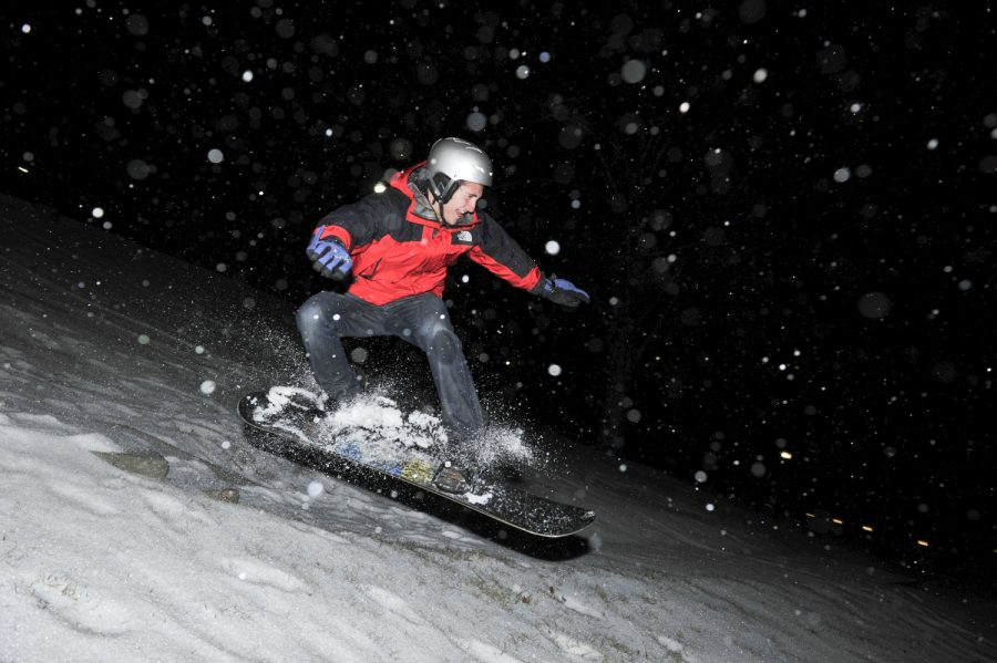 Owensboro senior Griffin Fruge snowboards down the hill in front of Van Meter Hall at around 1 a.m. on Monday morning. WKU campuses were closed on Monday due to inclementweather. (Jeff Brown/HERALD)