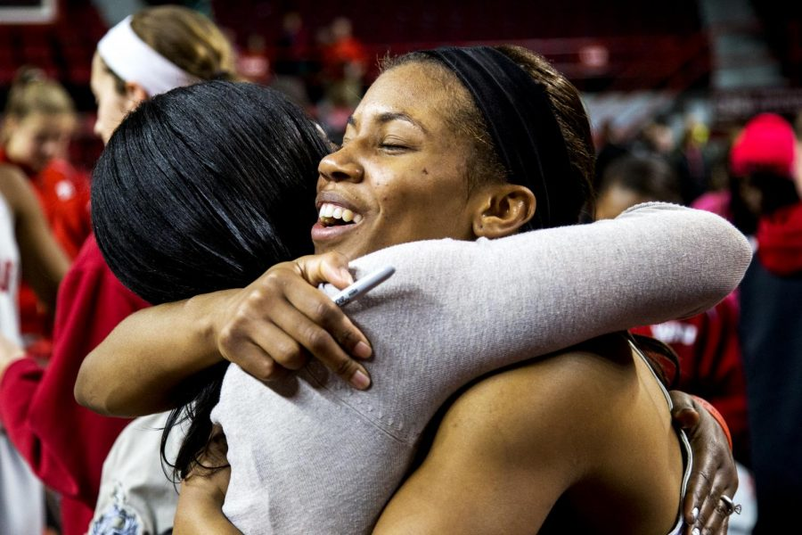 WKU senior guard Bianca McGee gets a hug from her sister Jonieka Martin after playing her final home game as a Lady Topper, an 80-71 victory over the University of Louisiana Lafayette Wednesday, March 5, 2014 at Diddle Arena in Bowling Green, Ky. Martin traveled from Indianapolis to watch her sisters final game. (Mike Clark/HERALD)