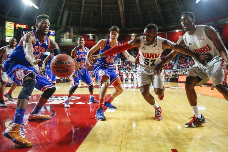 WKU+junior+guard+T.J.+Price+%2852%29+and+UT+Arlington+forward+Brandon+Williams+%2811%29+reach+for+a+loose+ball+during+a+basketball+game+between+the+Western+Kentucky+Hilltoppers+and+UT+Arlington+at+E.A.+Diddle+Arena+in+Bowling+Green%2C+Ky.+on+Thursday%2C+Jan.+30%2C+2014.+%28Jabin+Botsford+%2F+College+Heights+Herald%29