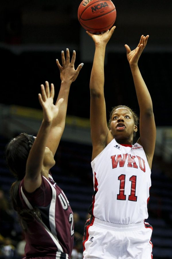 WKU+freshman+forward+Bria+Gaines+%2811%29+shoots+over+UALR+forward+Shanity+James+%2820%29+during+the+first+half+of+WKU%27s+game+against+the+University+of+Arkansas+Little+Rock+in+the+semifinal+round+of+the+Sun+Belt+Tournament+Friday%2C+March+14%2C+2014%2C+at+Lakefront+Arena+in+New+Orleans%2C+La.+The+Lady+Toppers+won+66-62.+%28Mike+Clark%2FHERALD%29