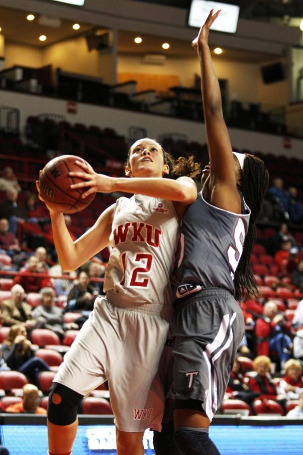 WKU+freshman+guard+Kendall+Noble+goes+up+for+a+basket+against+Troy+senior+forward+Dominique+Ross+during+the+first+half+of+their+game+at+Diddle+Arena%2C+Wednesday%2C+February+12th%2C+2014.+The+Lady+Toppers+lead+52-19+at+half.+%28Ian+Maule%2FHERALD%29