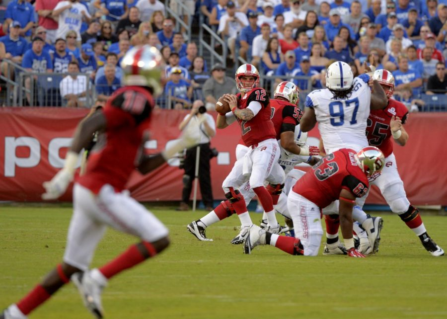 WKU quarterback Brandon Doughty prepares to pass the ball to wide receiver Nicholas Norris during the game against University of Kentucky at LP Field on Saturday, August 31.
